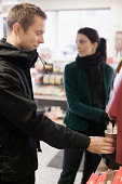 Young couple having coffee at gas station