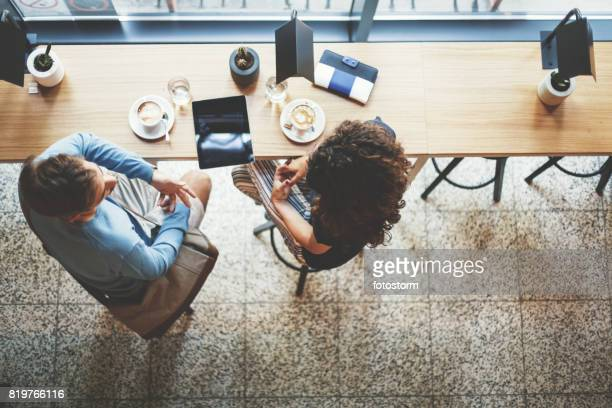 Young couple having coffee together in cafe