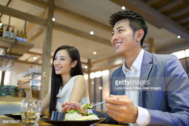 Young couple having dinner together