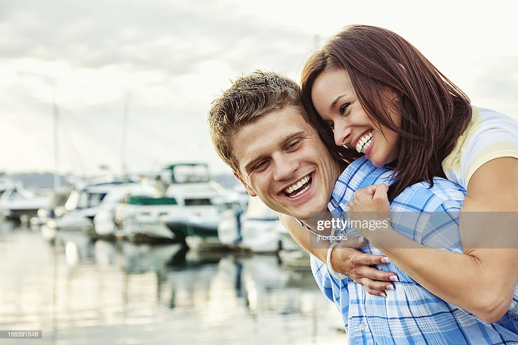 Young Couple Having Fun at Boat Dock