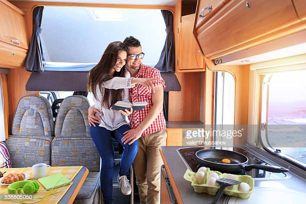 Young couple having fun at camper