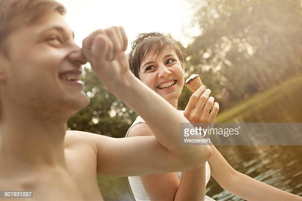 Young couple having fun at quarry pond