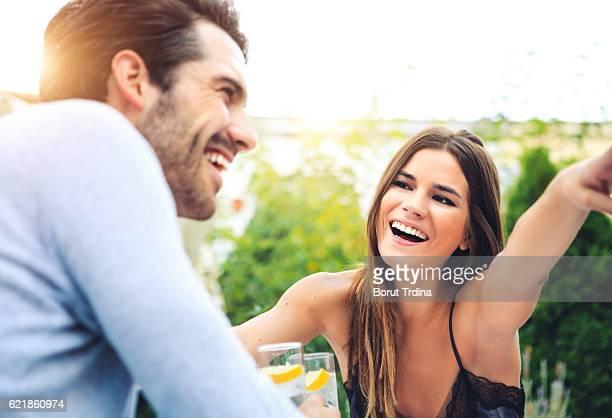 Young Couple Having Fun In An Outdoor Bar
