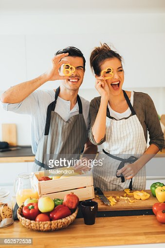 Young couple having fun in the kitchen : Stock Photo