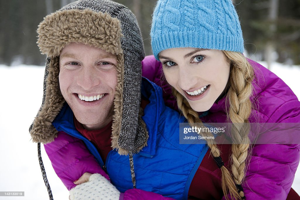 Young couple having fun in the snow. : Stock Photo
