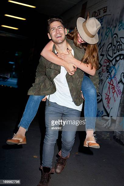 Young couple having fun on piggy back