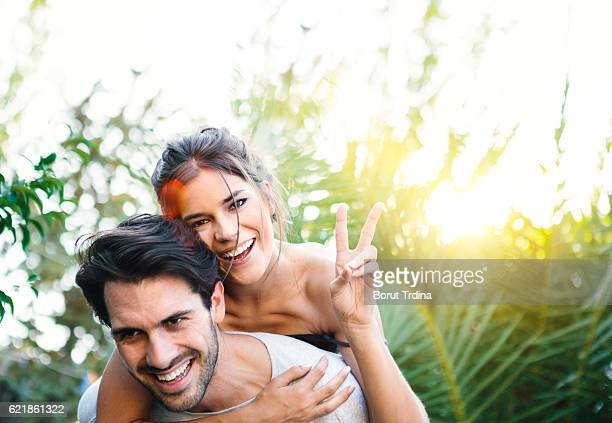 Young Couple Having Fun Piggyback Riding