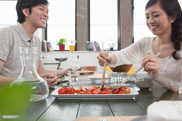 Young couple having lunch at table