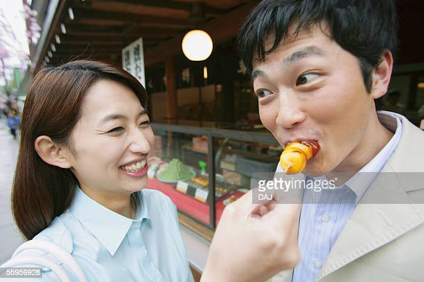 Young Couple Having Rice Cake, Tokyo, Japan