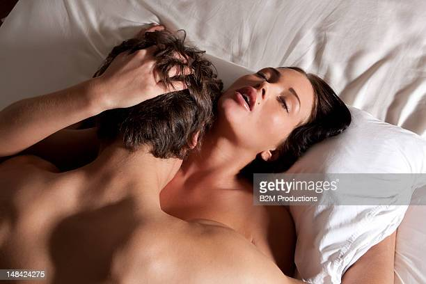 Young couple having sex in bed