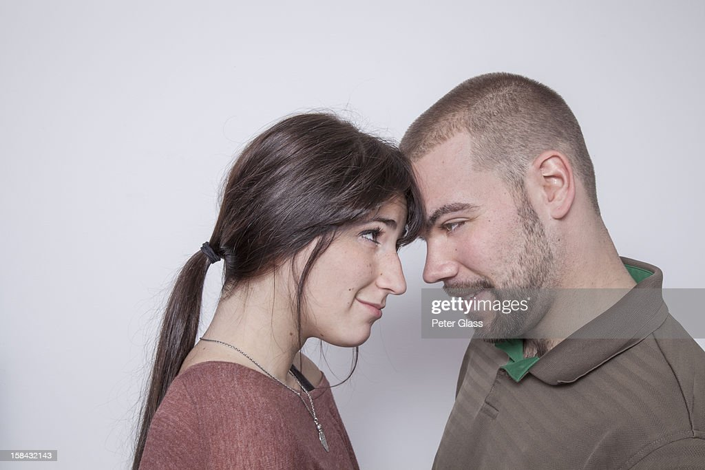 Young couple head to head : Stock Photo