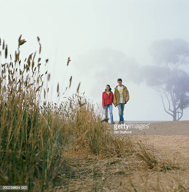 Young couple hiking in canyon