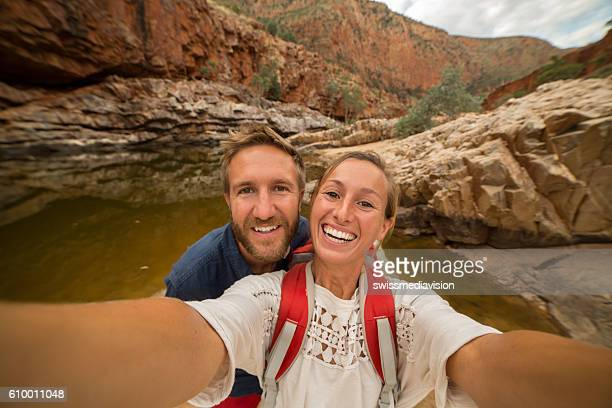 Young couple hiking take a selfie portrait