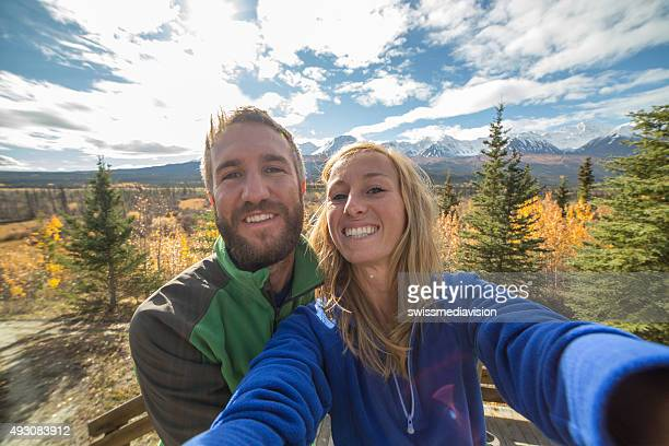 Young couple hiking takes selfie portrait in nature
