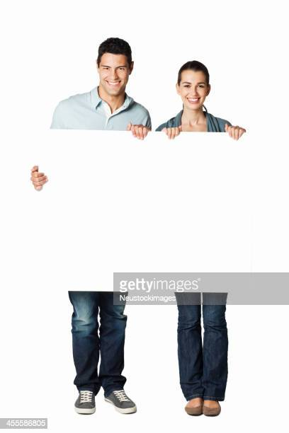 Young Couple Holding a Blank Sign - Isolated