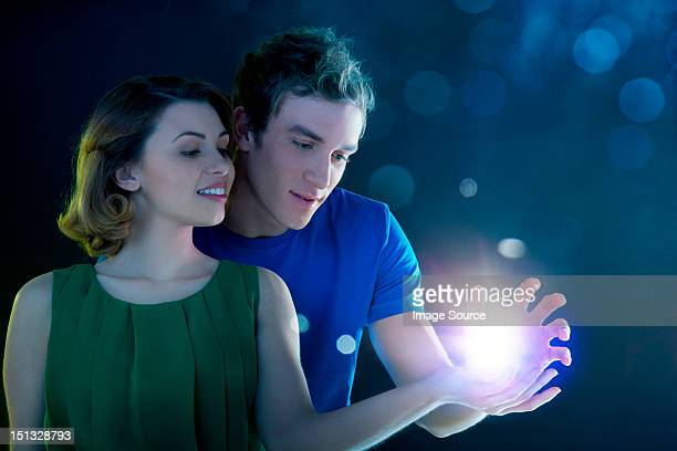 Young couple holding light