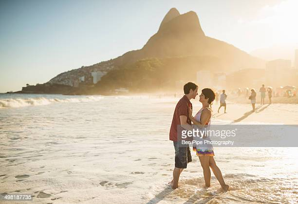 Young couple hugging at sunset, Ipanema Beach, Rio, Brazil