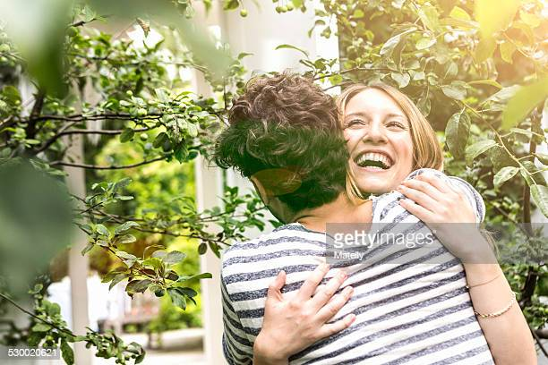 Young couple hugging in garden