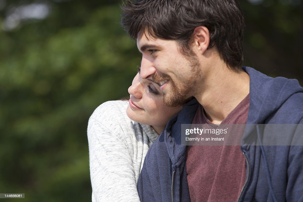 Young couple hugging in nature : Stock Photo
