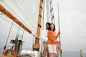 Young couple hugging in sailing boat