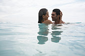 Young couple hugging in water (low angle view), St. John, US Virgin Islands, USA