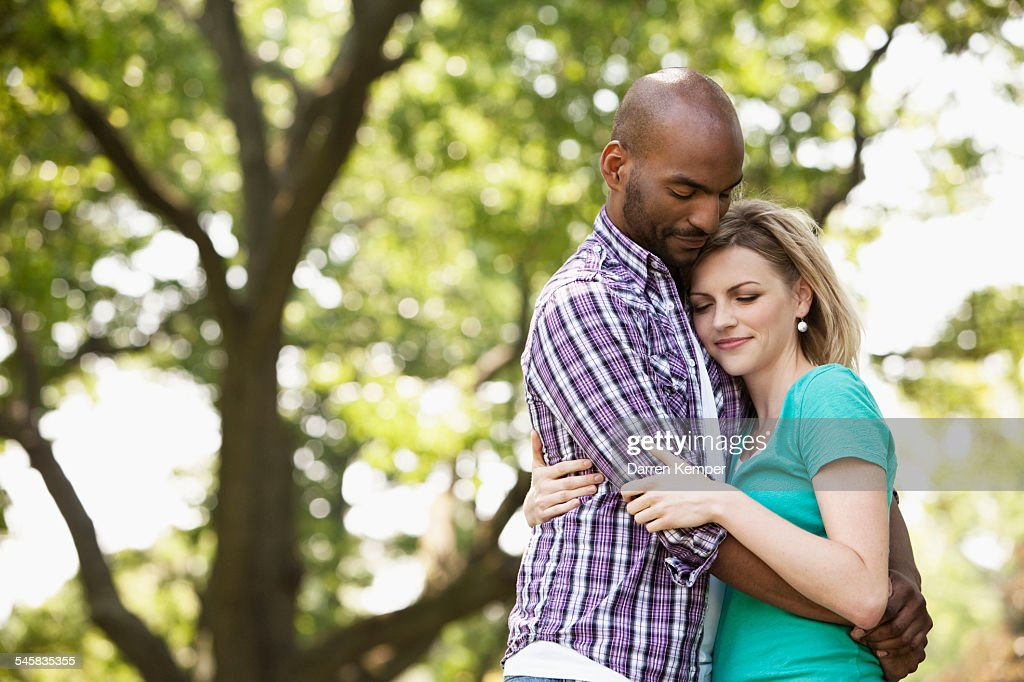 Young couple hugging : Stock Photo