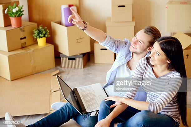 young couple in a new apartment with boxes for moving