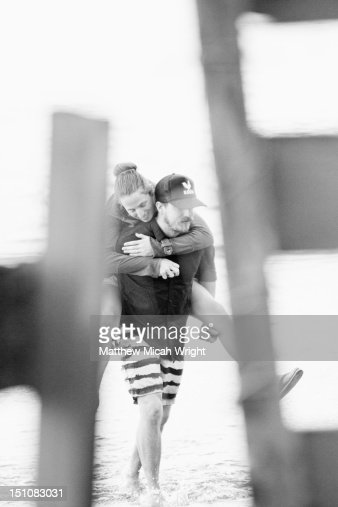 A young couple in a piggy back ride. : Stock Photo