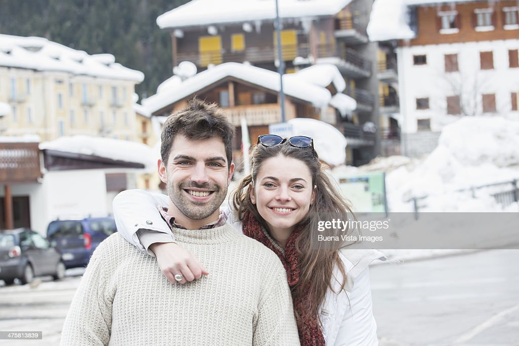Young couple in a ski resort : Stock Photo