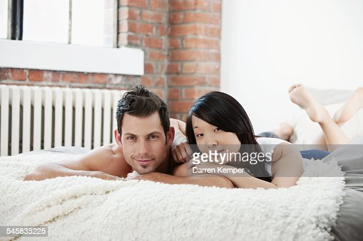 Young couple in bed : Stock-Foto