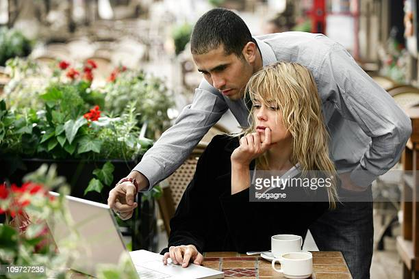 Young Couple in Cafe Working on Laptop