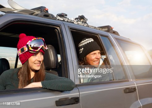 Young Couple In Car Looking Over Bansko Scenery