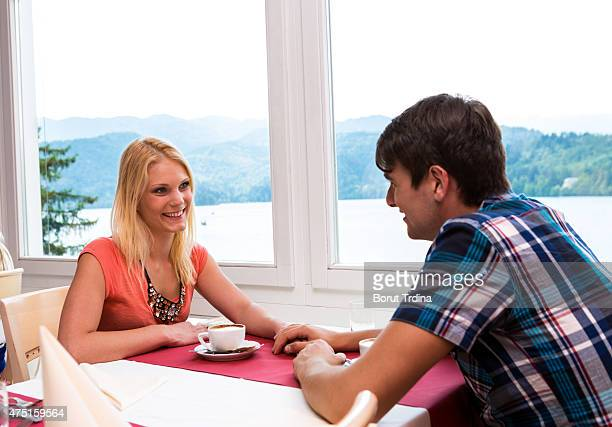Young Couple In Coffee House