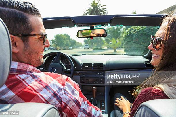 Young couple in convertible, San Diego, California, USA