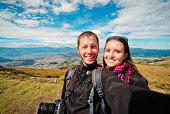 Young couple in Cruz Loma - Quito panoramic view