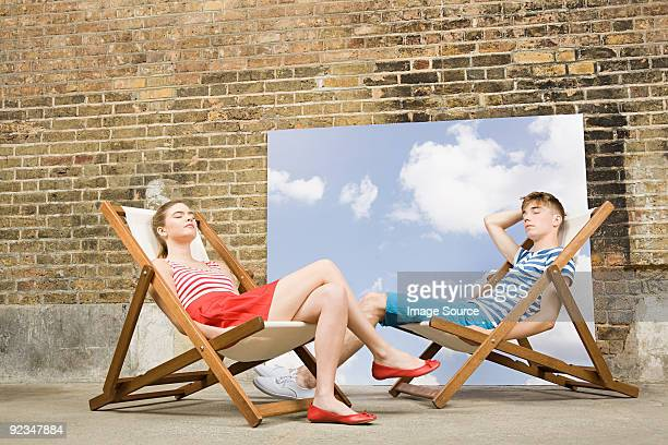 Young couple in deckchairs