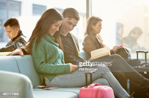 Young couple in departure lounge
