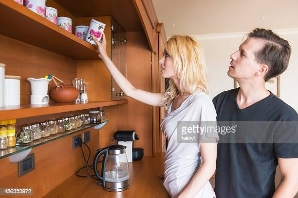 Young couple in domestic kitchen