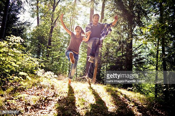Young couple in forest, having fun, Bavaria, Germany
