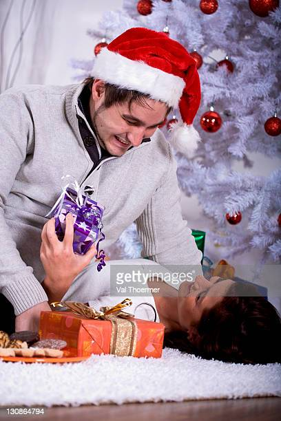 Young couple in front of a Christmas tree
