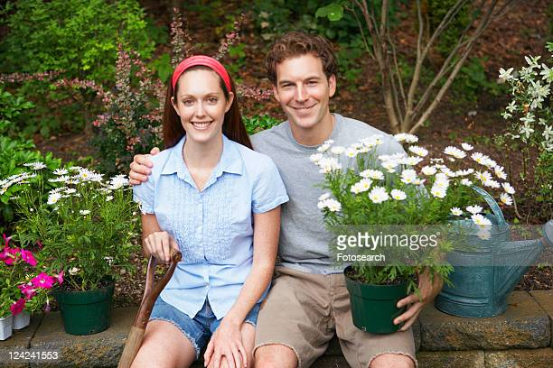 Young couple in garden (portrait)