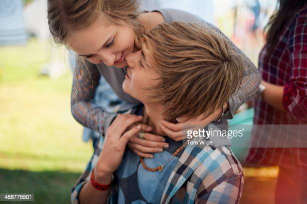 Young couple in gentle embrace
