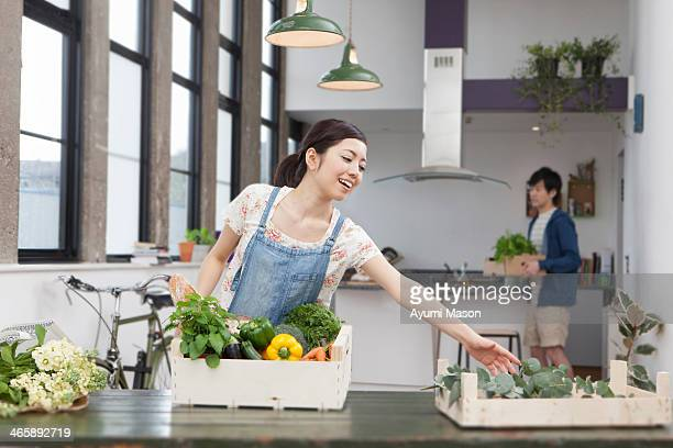 Young couple in kitchen preparing fresh food