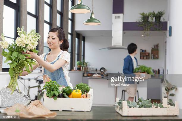 Young couple in kitchen preparing meal