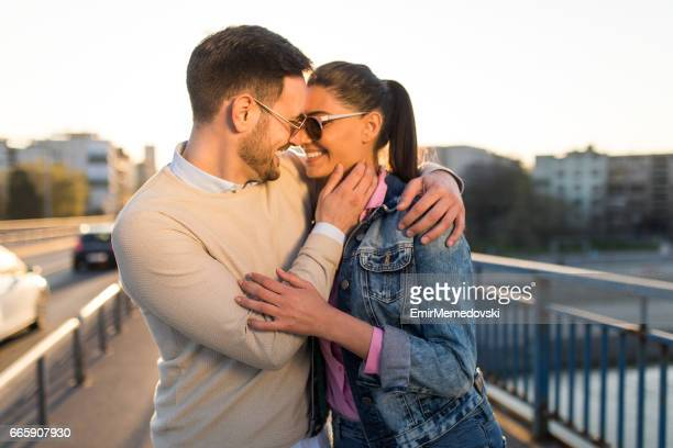 Young couple in love embracing on a bridge