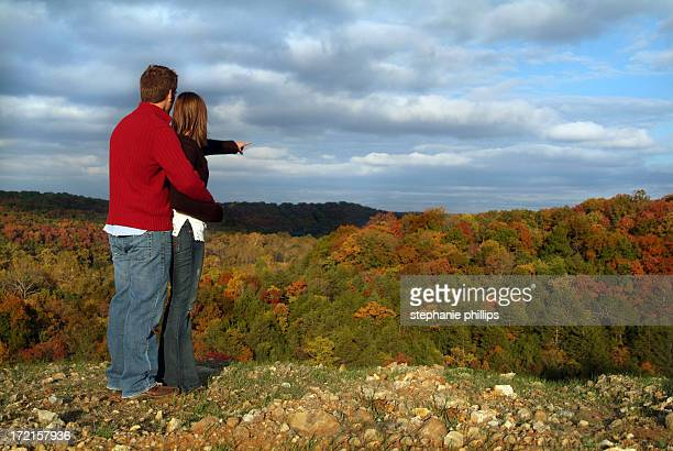 Young Couple in Love Standing on a Ridge in Autumn