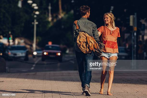 Young couple in love walking on the street