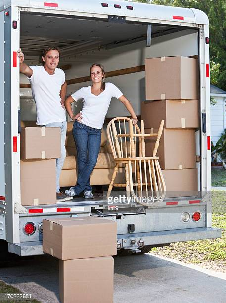 Young couple in moving van