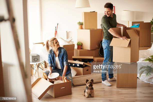 Young couple in new apartment with small dog. Debica, Poland