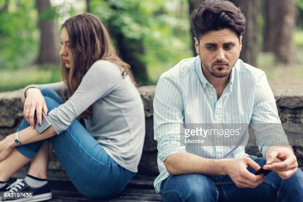 Young couple in relationship difficulties staying away from each other